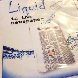 Agua/leche en el periodico